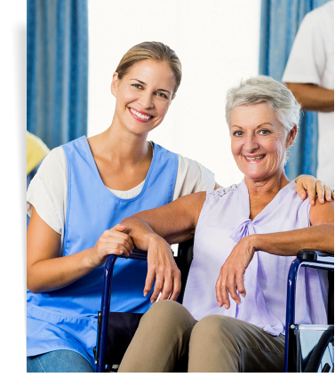 woman and patient in wheelchair smiling