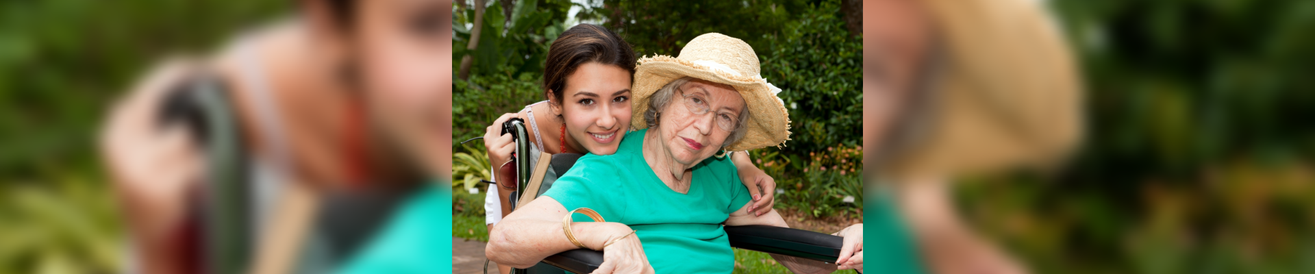 caregiver and patient in wheelchair smiling