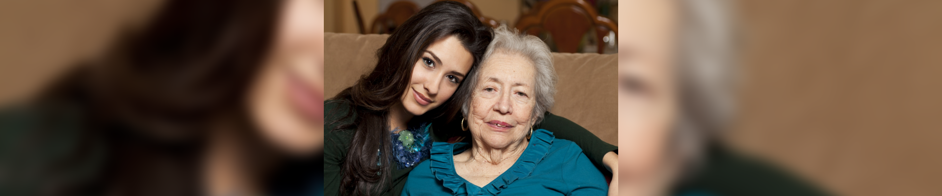 woman with her caregiver smiling